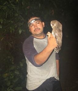 William, a BFREE ornothologist, holds a modeled owl.
