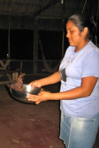 Maya winnowing the roasted and cleaned beans.