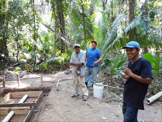Leonard Ical (left) and his staff poured cement slabs for three composting toilet facilities over the summer.