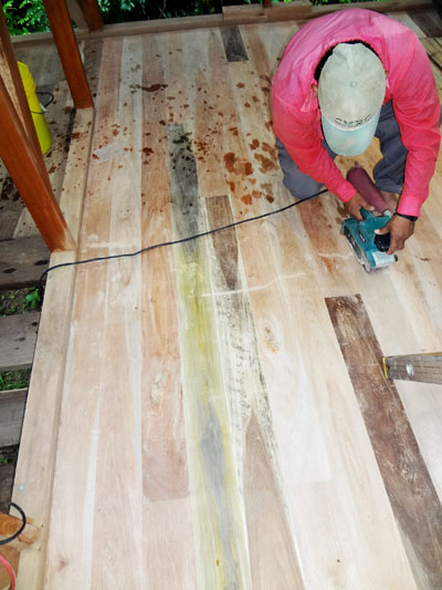 Marcelino Pop sands the hardwood floor on the first of three researcher cabins.
