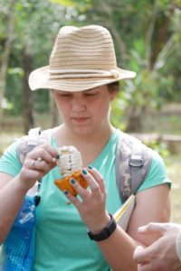 Lakeland College student tastes the cacao fruit